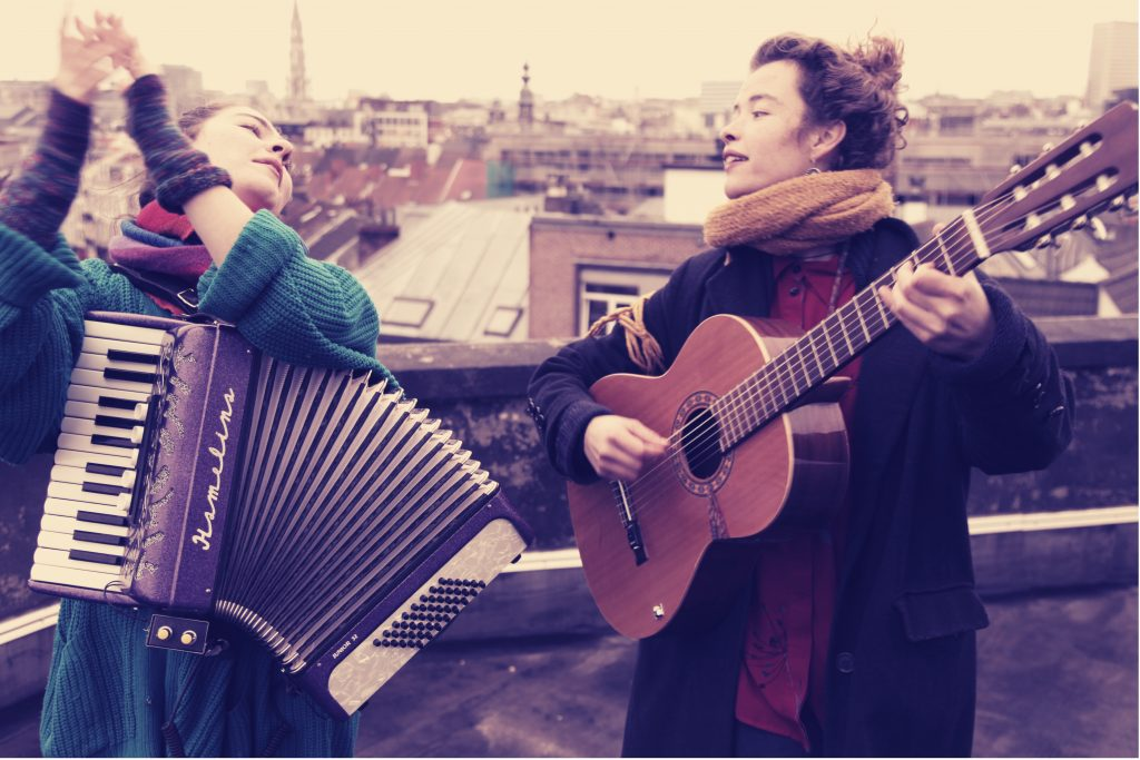 singers with instruments on a rooftop
