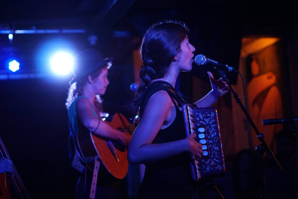 two singers with acordeon and guitar at a concert