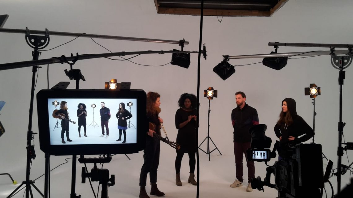 Four musicians in a studio
